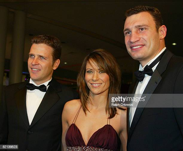 Former German footballer Oliver Bierhoff his wife Klara and Ukraine boxer Vitali Klitschko attend the Ball Des Sports Gala Evening at the Festhalle...