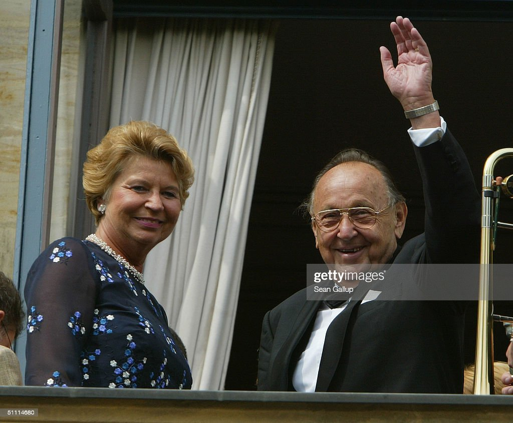 Former German foreign minister Hans-Dietrich Genscher and his wife Barbara wave from the balcony of the festival house after arriving for the opening performance of Richard Wagner's 'Parsifal' July 25, 2004 on the first day of the 93rd Richard Wagner Festival in Bayreuth, Germany.