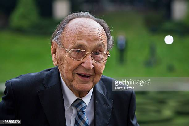 Former German Foreign Minister Hans-Dietrich Genscher stands on the balcony at a commemoration event to the 25th anniversary of refugee exodus from...