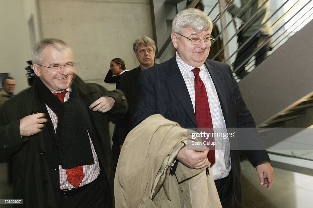 Former German Foreign Minister Joschka Fischer(R) leaves after testifying at a session of parliamentary hearings into the case of Khalid El-Masri, a German citizen kidnnapped by the CIA, at the Bundestag December 14, 2006 in Berlin, Germany. El Masri was detained by the CIA in 2004 and held for several months at a prison for terrorists in Afghanistan, before being released following confirmation that he was not in fact the person the CIA had originally thought. The hearings now in Berlin are focusing on whether German officials at the time knew of or had a role in El Masri's detention.