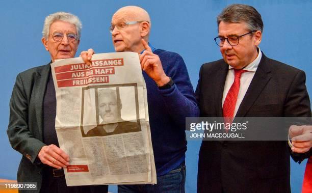 Former German Interior Minister Gerhart Baum, German investigative journalist Guenter Wallraff and former German Foreign Minister Sigmar Gabriel pose...