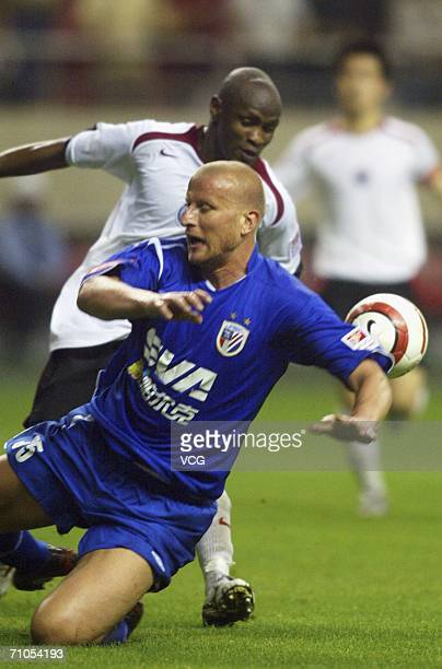 Former German International Carsten Jancker challenges for the ball during the match between Shanghai Shenhua and Liaoning at Hongkou Stadium on May...