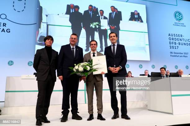 Former German national player Philipp Lahm is awarded as German national team honorary team captain by DFB president Reinhard Grindel German national...