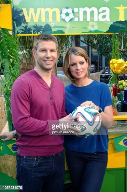 Former German national soccer player Thomas Hitzlsperger and TV presenter Jessy Wellmer pose in the ZDF Moma World Cup Cafe in Berlin, Germany, 12...