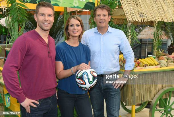 Former German national soccer player Thomas Hitzlsperger , TV presenter Jessy Wellmer and managing editor Thomas Fuhrmann pose in the ZDF Moma World...