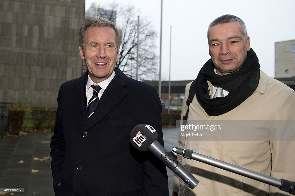 Former German President Christian Wulff and his advocate Bernd Muessig arrives at the Landgericht Hannover courthouse for the third day of his trial on November 27, 2013 in Hanover, Germany. Wulff is accused of accepting favors while he was governor of Lower Saxony, a charge that prompted him to resign last year from his office as president. Wulff is the first post-World War II German president to face a court trial.