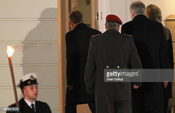 Former German President Christian Wulff departs at the conclusion of the Zapfenstreich or taps farewell ceremony for Wulff at Bellevue Palace on...