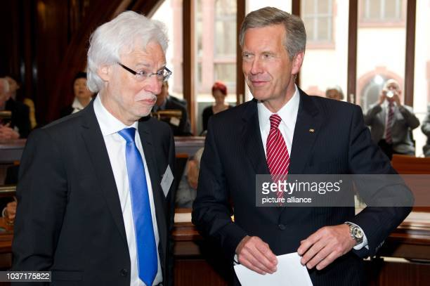 Former German president Christian Wulff talks with the Major of Hanover Bernd Strauch in the Neues Rathaus in Hanover Germany 10 May 2013 Wulff gave...