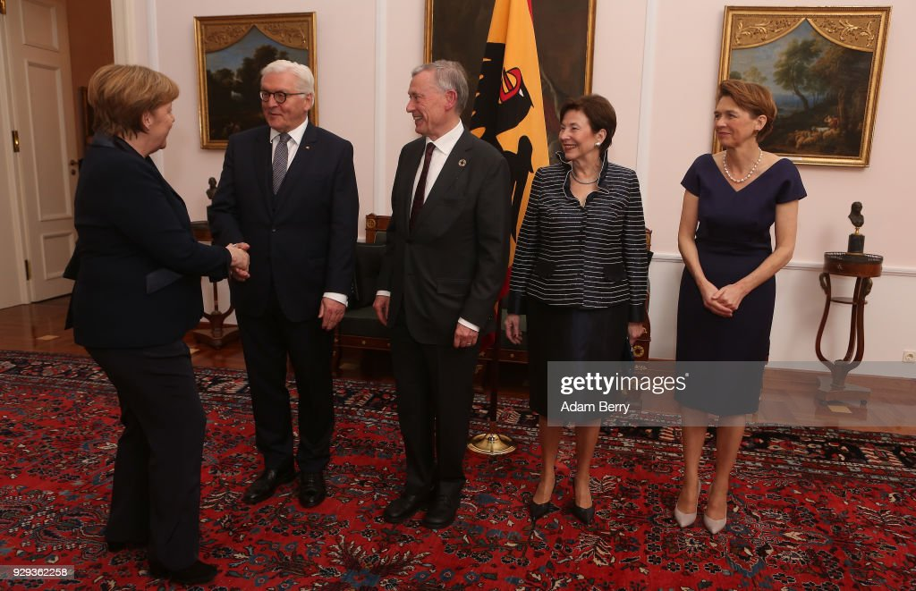 Former German President Horst Koehler (3rd from L) attends a dinner in his honor during his 75th birthday, next to Koehler's wife Eva Luise Koehler (2nd from R), German President Frank-Walter Steinmeier (2nd from L), Steinmeier's wife Elke Buedenbender (R) and German Chancellor Angela Merkel (L) at Bellevue Palace on March 8, 2018 in Berlin, Germany. Koehler was president of Germany from 2004 to 2010.