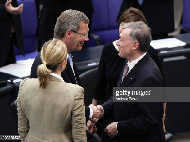 Former German President Horst Koehler shakes hands with the new German President Christian Wulff and his wife Bettina during the official...