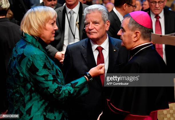 Former German president Joachim Gauck Green Party politician Claudia Roth and Papal Nuncio Nikola Eterovic before an official ceremony on the...