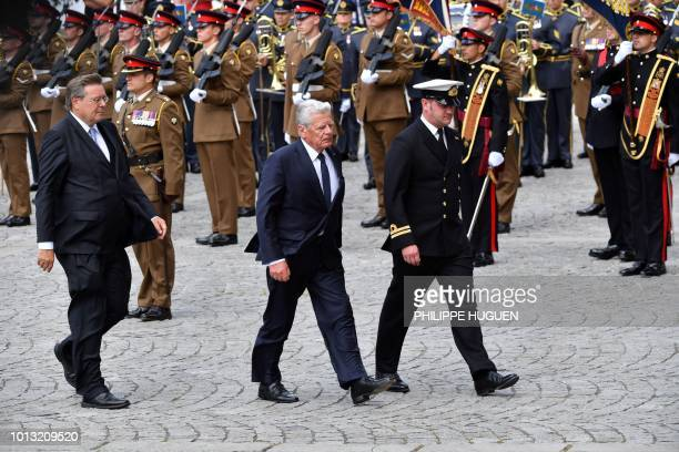 Former German President Joachim Gauck walks with officials in Amiens northern France on August 8 as they arrive to attend a ceremony to mark the...