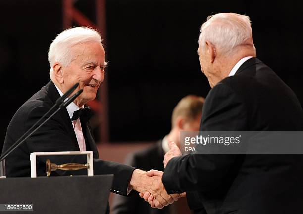 Former German President Richard von Weizaecker shakes hands with Director of Berlin Jewish Museum Michael Blumenthal at the Jewish Museum in Berlin...