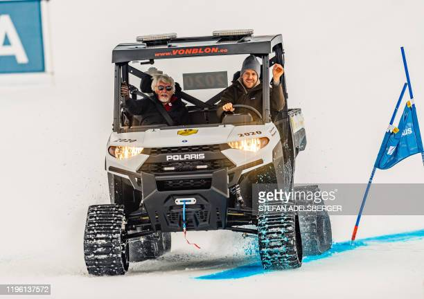 Former German racing driver Sebastian Vettel and British business magnate Bernie Ecclestone are seen during the KitzCharityTrophy 2020 sideline event...