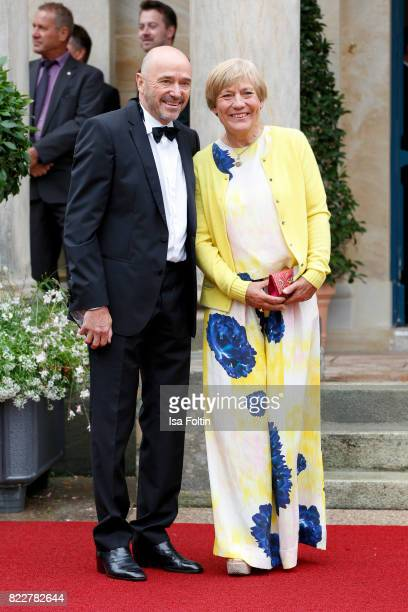 Former German skier Christian Neureuther and his wife former skier Rosi Mittermaier attend the Bayreuth Festival 2017 Opening on July 25 2017 in...