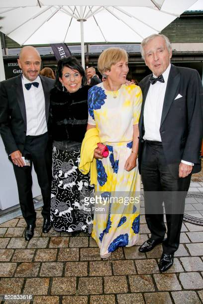Former German skier Christian Neureuther with his wife former German skiere Rosi Mittermaier and Regine Sixt with her husband Erich Sixt attend the...