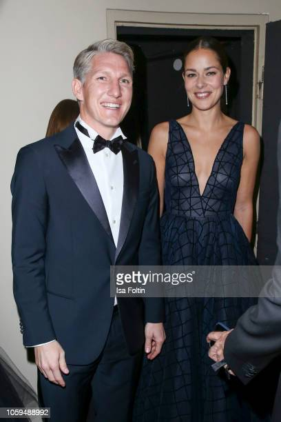 Former German soccer player Bastian Schweinsteiger and his wife Ana IvanovicSchweinsteiger attend the GQ Men of the Year Award after show party at...