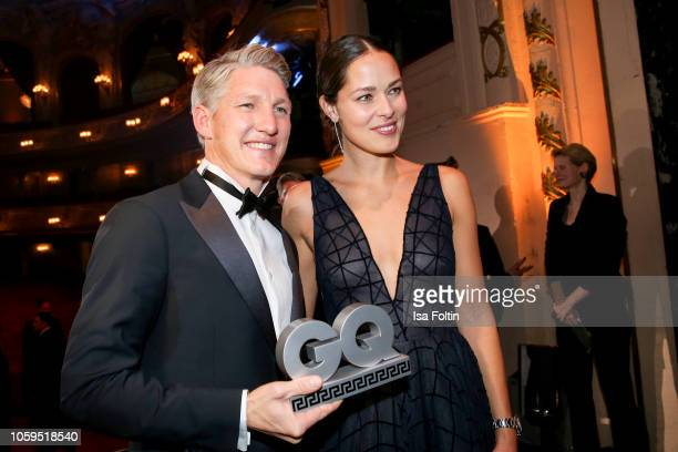 Former German soccer player Bastian Schweinsteiger and his wife Ana IvanovicSchweinsteiger are seen on stage during the GQ Men of the Year Award show...