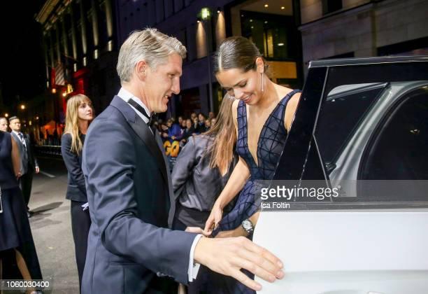 Former German soccer player Bastian Schweinsteiger and his wife Ana IvanovicSchweinsteiger arrive for the 20th GQ Men of the Year Award at Komische...