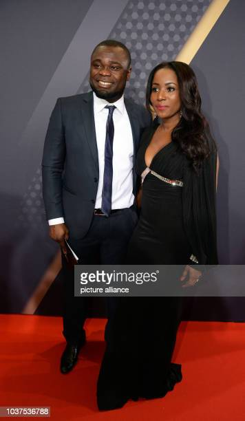 Former German soccer player Gerald Asamoah arrives with his wife Linda at the FIFA Ballon d'Or Gala 2015 held at the Kongresshaus in Zurich...