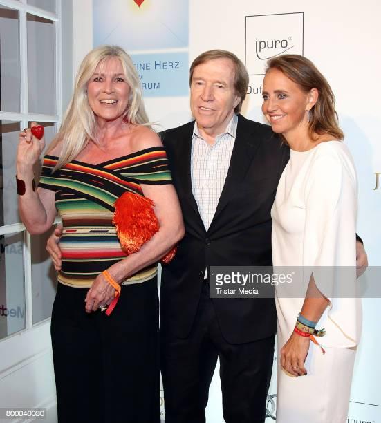 Former german soccer player Guenther Netzerr with his wife Elvira Netzer and Jonica Jahr attend the Charity Evening 'Das kleine Herz im Zentrum' at...