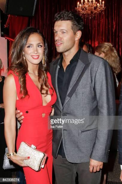 Former german soccer player Michael Ballack and his girlfriend Natacha Tannous attend the 'Nacht der Legenden' at Schmidts Tivoli on September 3,...