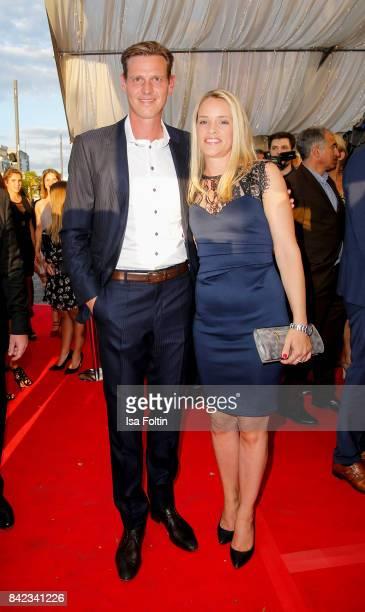 Former german soccer player Tim Borowski and his wife Lena Muehlbacher attend the 'Nacht der Legenden' at Schmidts Tivoli on September 3 2017 in...