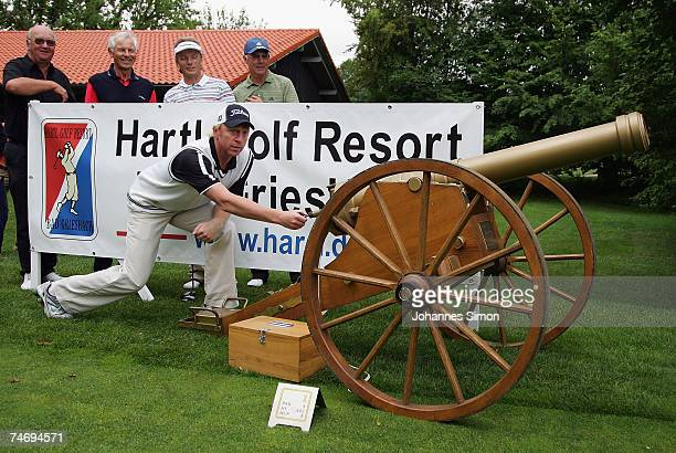 Former German tennis legend Boris Becker opens the Hartl Golf Resort by firing a cannon shot with Alois Hartl HansDieter Cleven Bernhard Langer and...