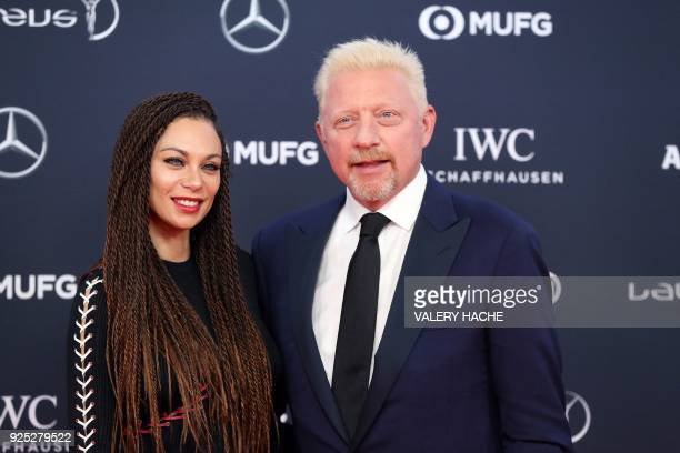 Former German tennis player Boris Becker and his wife Lilly Becker pose as they arrive for the 2018 Laureus World Sports Awards ceremony at the...