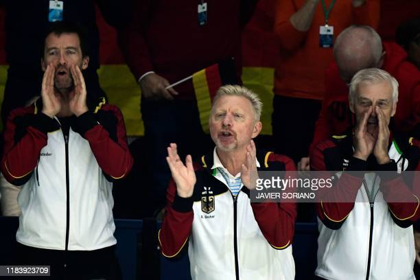 Former German tennis player Boris Becker cheers during a singles quarter-final tennis match between Great Britain and Germany at the Davis Cup Madrid...