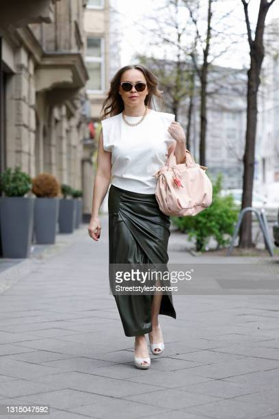 Former German world boxing champion Regina Halmich wearing black sunglasses with silver crystals by Gucci, a white top by Sonja Kiefer, a long dark...