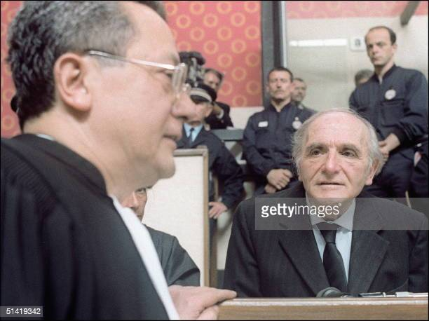Former Gestapo chief in Lyon during WWII and Nazi war criminal Klaus Barbie talks to his defender a highprofile French lawyer Jacques VergFs during...