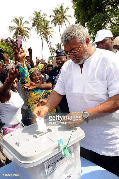 Former Ghanaian President and founder of the National Democratic Congress Jerry Rawlings cast his vote at a polling station in Accra on December 7...