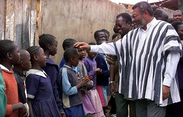 Former Ghanaian president Jerry Rawlings greets 29 September 2001 orphans at the Nyumbani Children's home in Nairobi Rawlings is in the country on a...