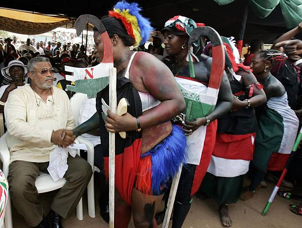 Former Ghanaian President Jerry Rawlings is greeted by NDC supporters during a meeting of NDC leader and Presidential candidate John Atta Mills 04...