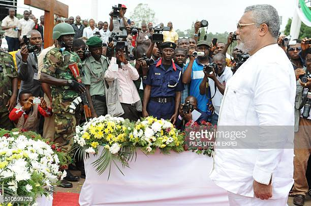 Former Ghanaian President Jerry Rawlings pays rest to Nigeria's seccessionist leader Odumegwu Ojukwu during the national interdenominational funeral...