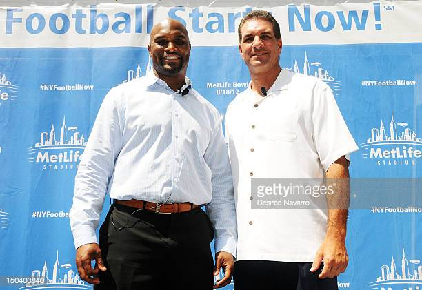 Former Giants wide receiver Amani Toomer and former Jets quarterback Vinny Testaverde attend Random Acts of Football 2012 Snoopy Statue Dedication...