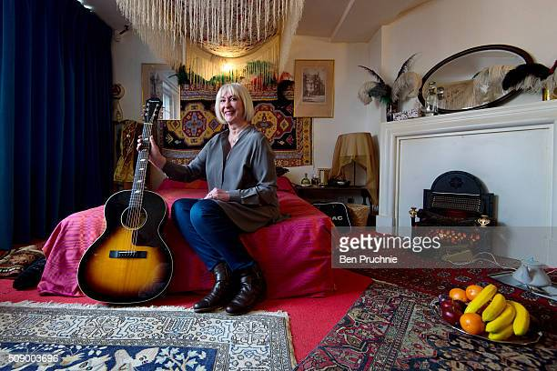 Former girlfriend of Jimi Hendrix Kathy Etchingham poses for a photograph in a recreation of his bedroom as it is displayed at the Handel and Hendrix...