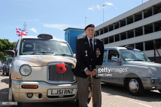 Former glider pilot Frank Ashleigh aged 92 stands by a taxi before setting off to the beaches of Normandy with the Taxi Charity for Military Veterans...