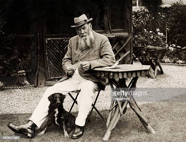 Former Gloucestershire and England cricketer Dr WG Grace seated with his dog, reading messages on his 66th birthday in the garden of his home in...