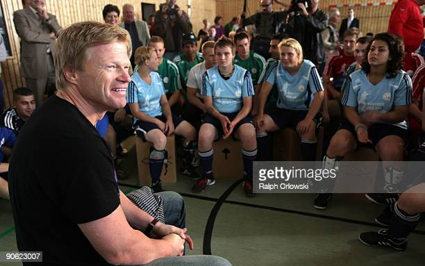 Former Goalkeeper Oliver Kahn of the German National Team speaks with young prisoners during a football tournament at a prison on September 12 2009...