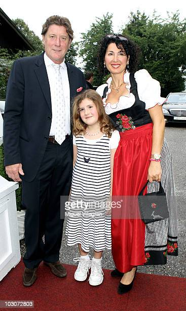 Former goalkeeper Toni Schumacher his wife Jasmin and their daughter PerlaMarie attend the gala dinner of the Kaisercup Golf tournament on July 24...