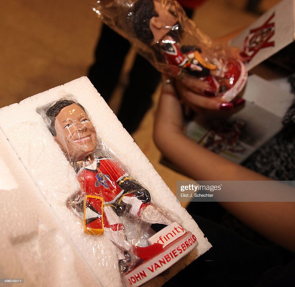 Former Goaltender John Vanbiesbrouck of the Florida Panthers has a bobblehead likeness for fans at their game against the Washington Capitals at the BB&T Center on December 13, 2013 in Sunrise, Florida.