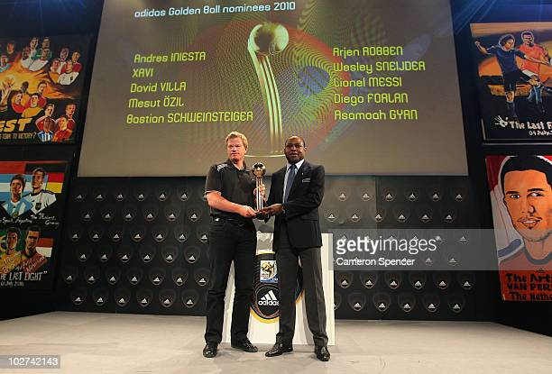 Former Golden Ball Award winner Oliver Kahn of Germany and FIFA technical Study Group member Kalusha Bwalya pose with the 'Golden Ball Award Trophy'...