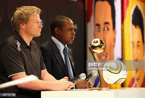 Former Golden Ball Award winner Oliver Kahn of Germany and FIFA technical Study Group member Kalusha Bwalya talk to media during an official...