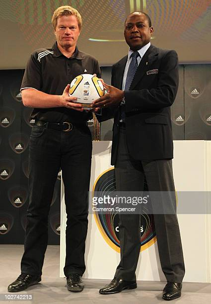 Former Golden Ball Award winner Oliver Kahn of Germany and FIFA technical Study Group member Kalusha Bwalya pose with the final match ball during an...