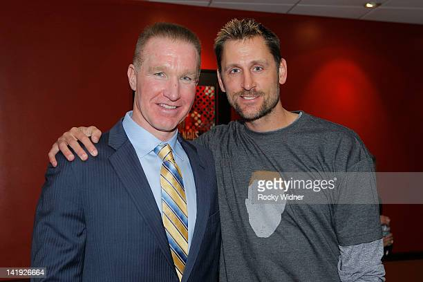 Former Golden State Warriors player Chris Mullin takes a picture with former NBA player Brent Barry on March 19 2012 at Oracle Arena in Oakland...