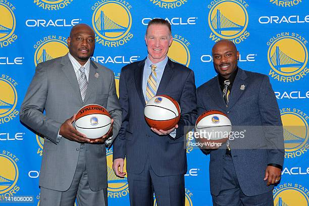 Former Golden State Warriors players from left Mitch Richmond Chris Mullin and Tim Hardaway pose during a ceremony to retire Mullin's jersey before...