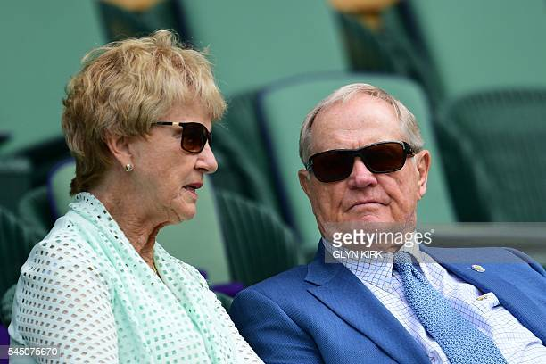 US former golfer Jack Nicklaus and his wife Barbara sit in the centre court crowd to watch US player Serena Williams play Russia's Anastasia...