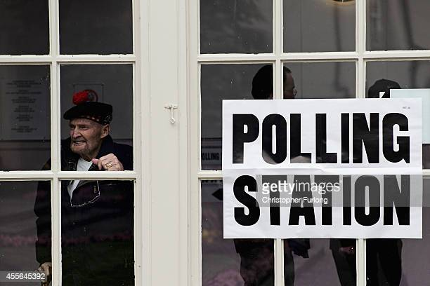 Former Gordon Highlander Jock Robertson aged 81 who said 'I have waited all my life for this vote' pauses at Peebles polling station after voting in...